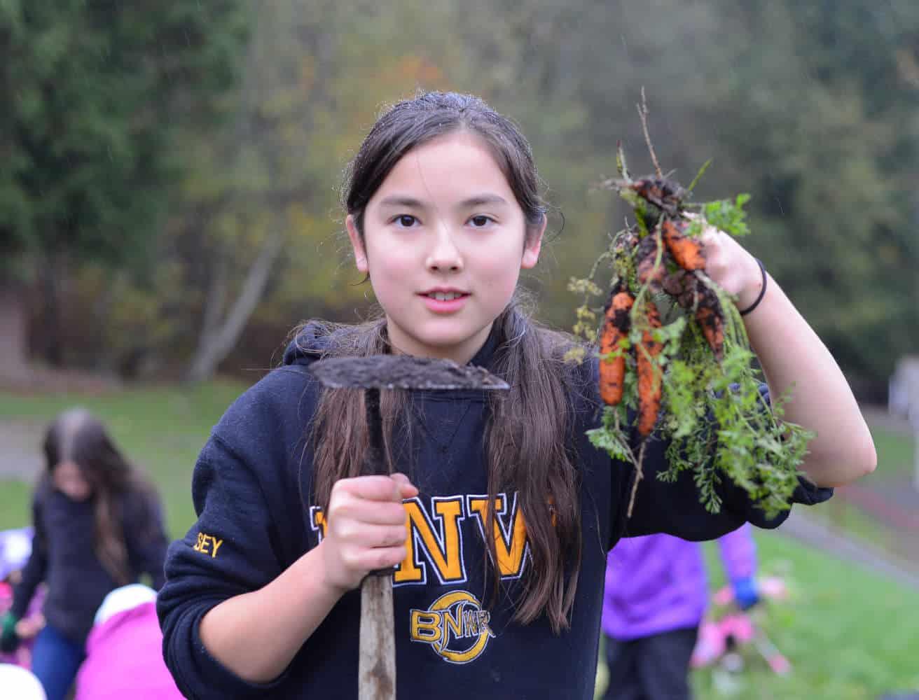 Girl holding carrots